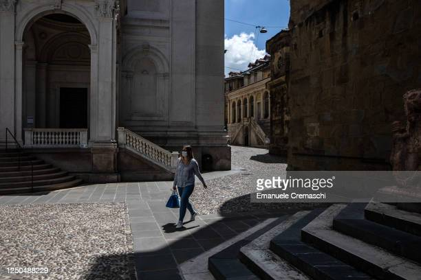 Young woman walks in the streets of the Upper Town on June 18, 2020 in Bergamo, Italy. The city of Bergamo is slowly returning to normality after the...
