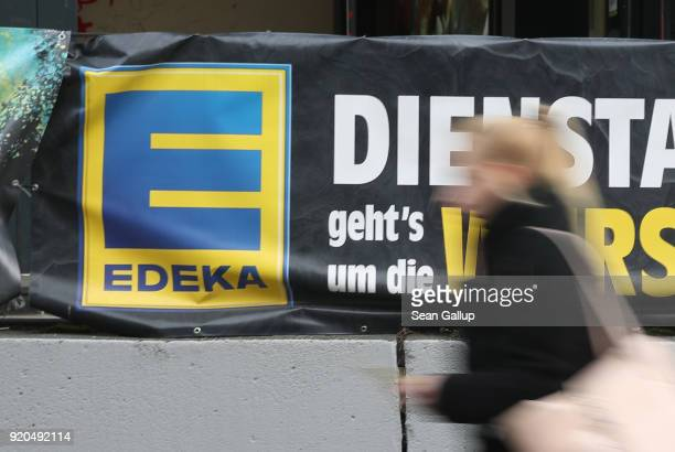 A young woman walks past a grocery store of German chain Edeka on February 19 2018 in Berlin Germany According to media reports AgecoreGroup to which...