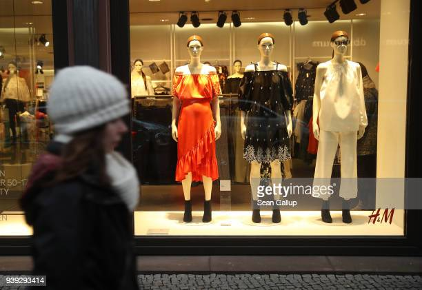 Young woman walks past a store of Swedish clothing retailer H&M on March 28, 2018 in Berlin, Germany. H&M, which is the world's second largest...