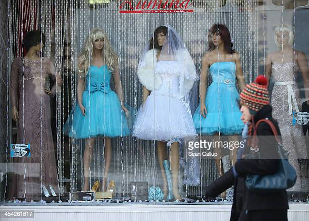 A young woman walks past a women's fashion shop on December 7 2013 in Sofia Bulgaria Restrictions on the freedom of Bulgarians and Romanians to work...