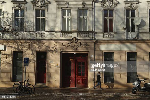 A young woman walks past the building that houses the former Fussilet 33 mosque in Perleberger Strasse street on January 5 2017 in Berlin Germany...