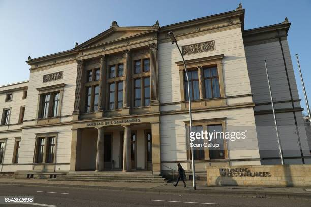 A young woman walks past the Saarland state parliament building on March 16 2017 in Saarbruecken Germany Saarbruecken is in the industrial heartland...