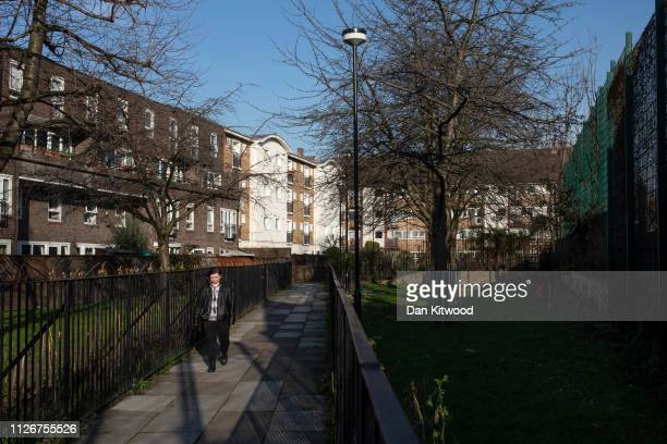 A young woman walks through an area of housing close to where the parents of Shamima Begum live in Bethnal Green on February 22 2019 in London...