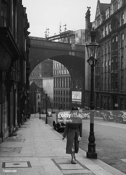 A young woman walks up Dean Street in Newcastle Upon Tyne 21st October 1950 Original Publication Picture Post 5138 Down The Tyne pub 1950