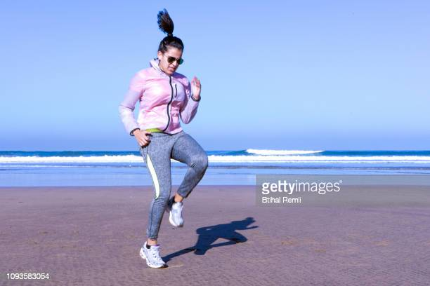 young woman warming up for sports