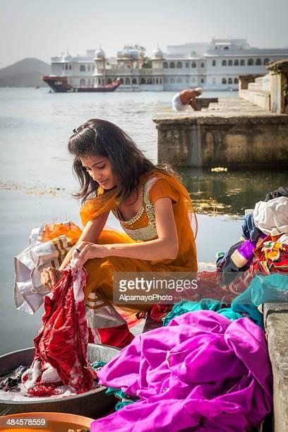 Young woman washing clothes at Ghats, Lake Pichola, Udaipur