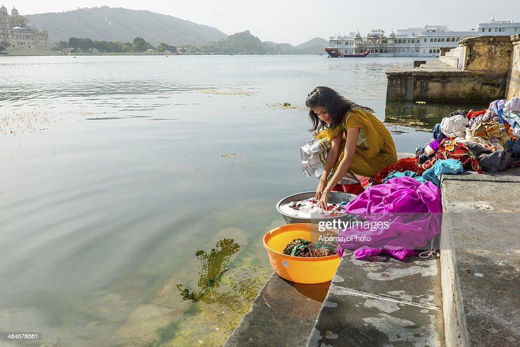 Young woman washing clothes at Ghats, Lake Pichola, Udaipur : Stock Photo