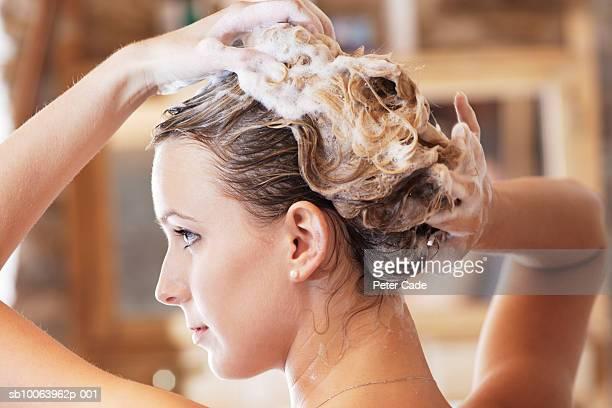 Young woman washing hair, close-up