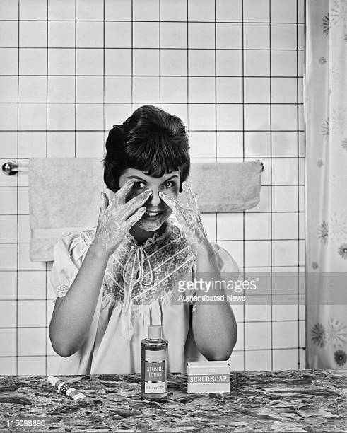 A young woman washing her face with Dorothy Gray Medicated Soap circa 1960