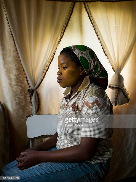 A young woman watches from her home as a crowd gathers on a hilltop for the Nelson Mandela funeral Qunu South Africa 14 December 2014 An icon of...
