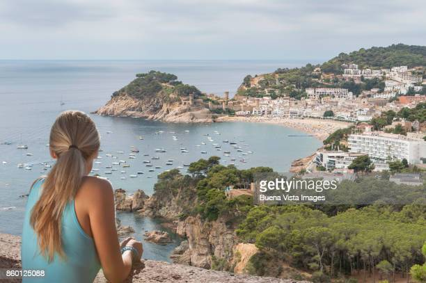 Young woman watching a mediterranean village.