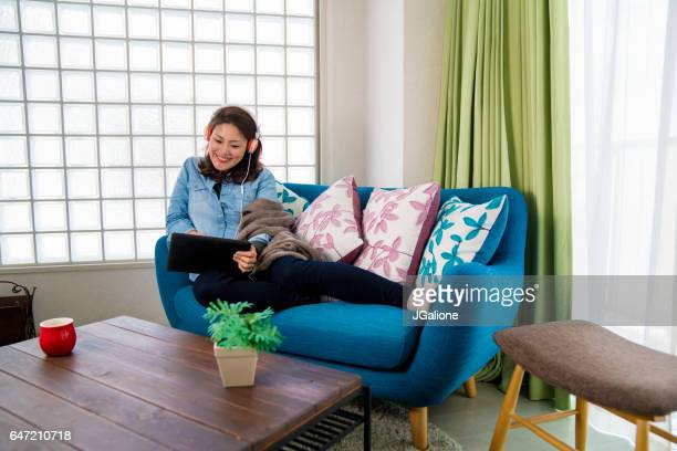 Young woman watching a movie at home