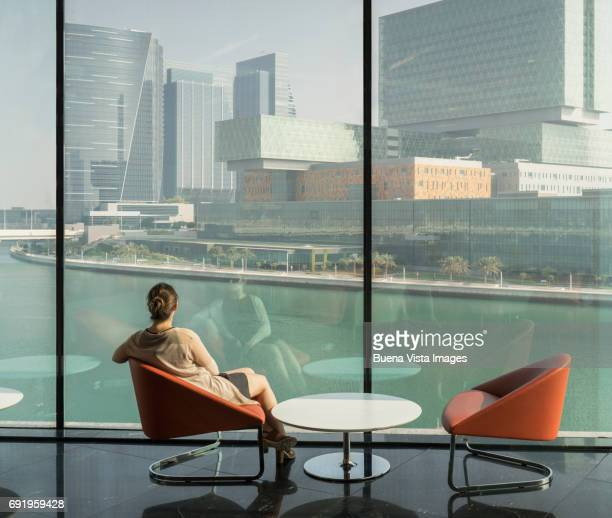 Young woman watching futuristic city.