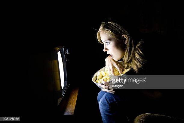 Young Woman Watching Movie in Dark