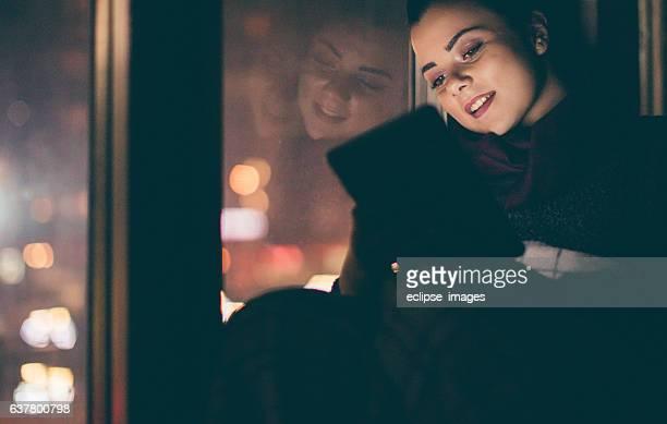 Young woman watching trought window