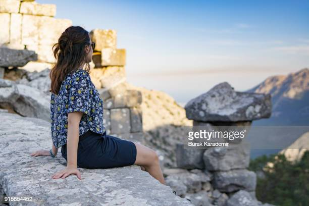 Young woman watching view in mountain
