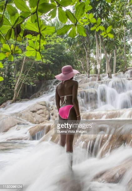 Young woman watching waterfall