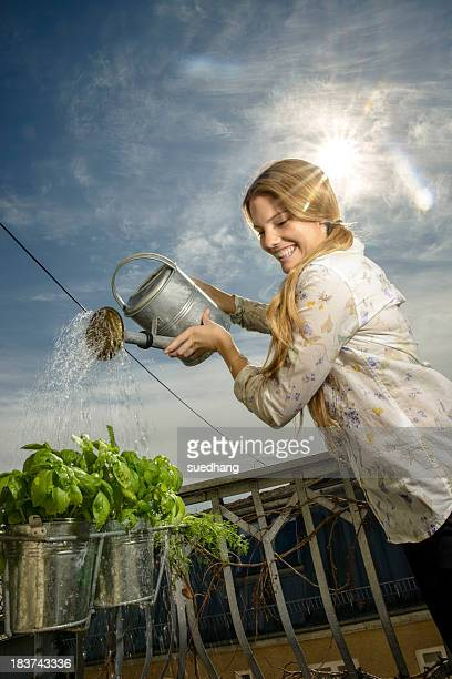 Young woman watering plants