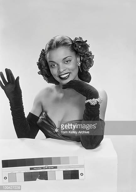 young woman waving hand, smiling - evening glove stock pictures, royalty-free photos & images