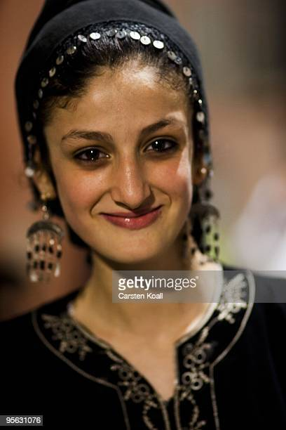 Young woman wearing a black traditional roma dress enjoys a wedding party in the district Tarlabasi on May 14, 2006 in Istanbul, Turkey. Tarlabasõ is...