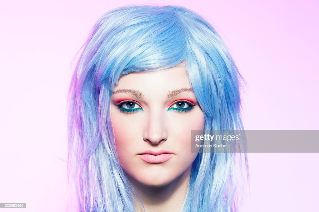 Young woman wearing a blue hair wig, portrait. : Stock Photo