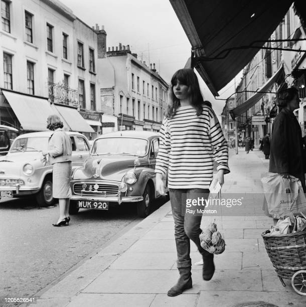 Young woman dressed in the fashionable style associated with the Chelsea bohemian set, London, September 1959. The contemporary caption describes the...