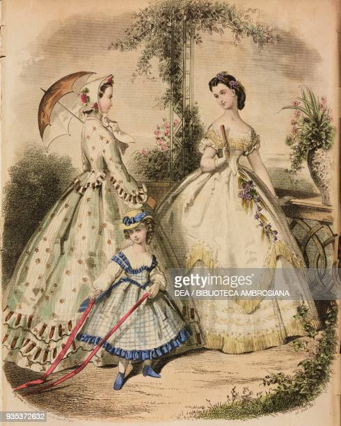 Young woman wearing a city dress and holding an umbrella teenage girl wearing a ball gown girl wearing a white and blue dress engraving by...