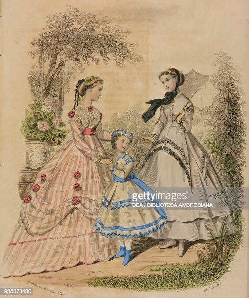 Young woman wearing a city or country dress teenage girl wearing a lightcoloured dress and holding an umbrella nineten yearold girl wearing a blue...