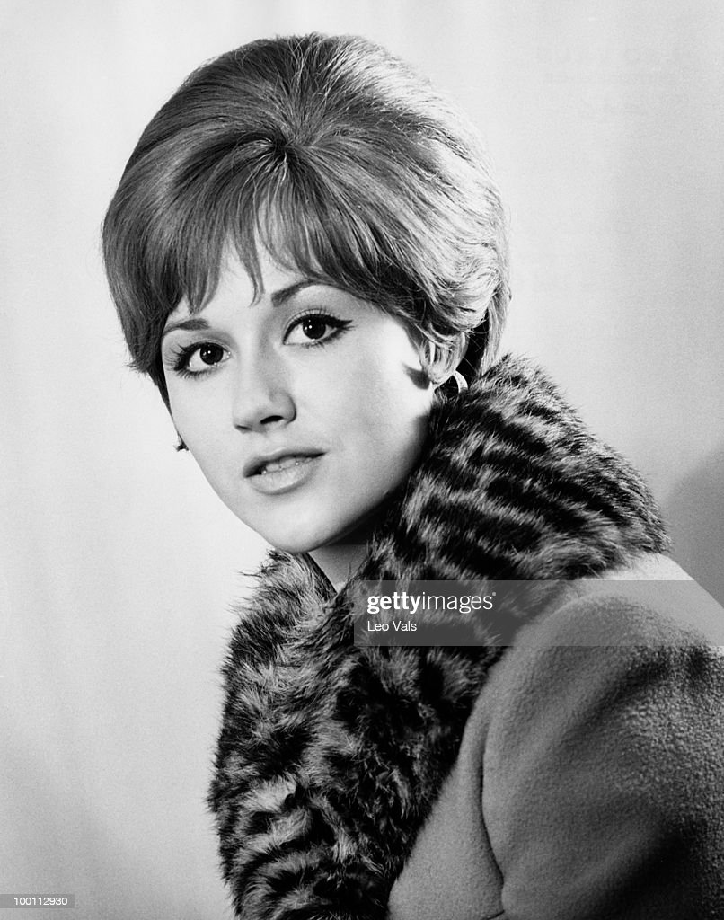 A young woman wearing a coat with a fur collar, circa 1967.