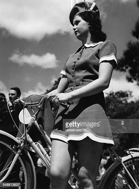 Young woman wearing a dress for riding bicycle 1938 Photographer Gyula H Brassai Published by 'Berliner Illustrirte Zeitung' 27/1938 Vintage property...