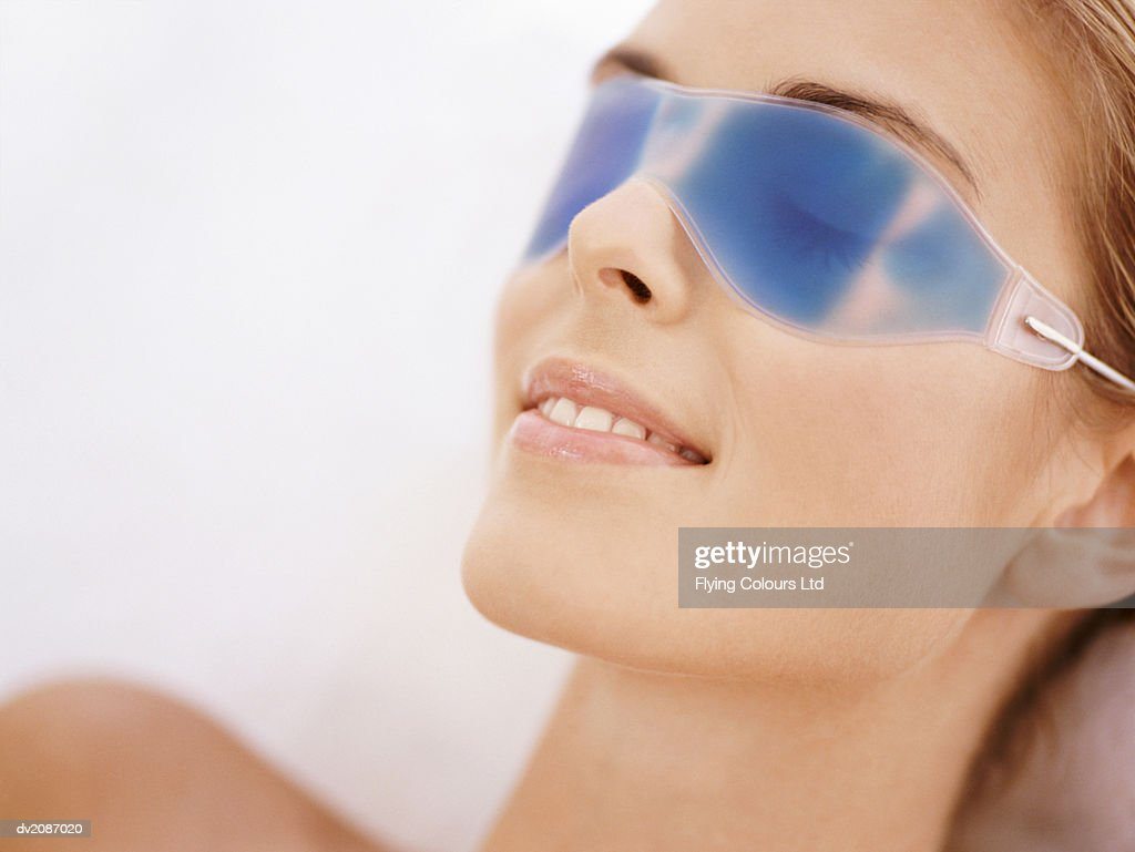 Young Woman Wearing a Gel Eye Mask : Stock Photo