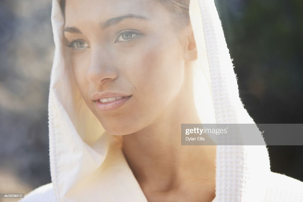 Young Woman Wearing a Hooded Bathrobe : Stock Photo
