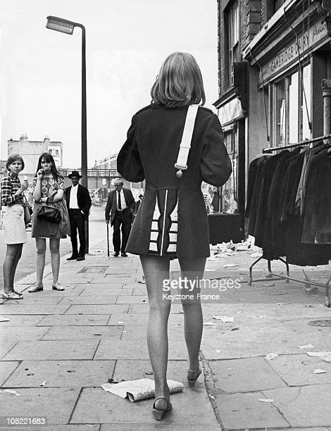 Young Woman Wearing A Military Jacket Over A Miniskirt On Portobello Road In London On August 1 1967