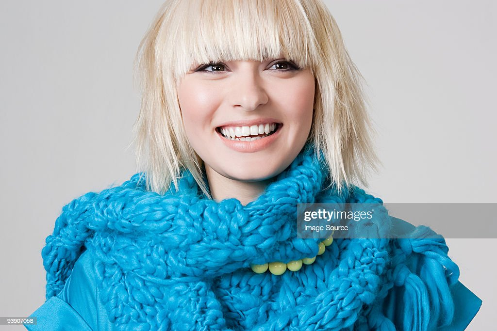 Young woman wearing a scarf : Stock Photo