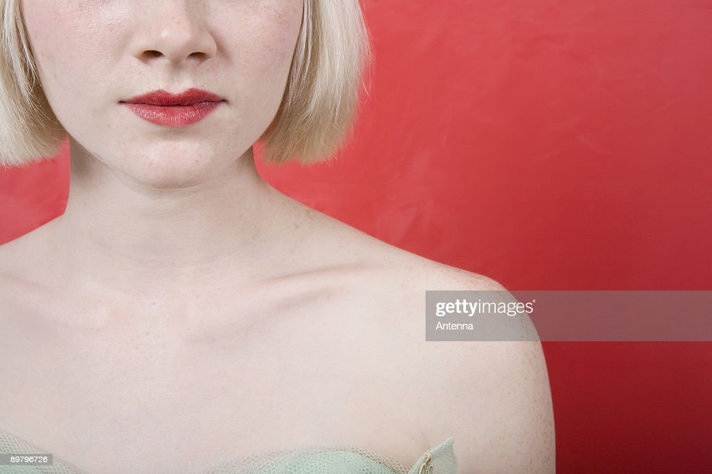 A young woman wearing a strapless vintage dress : Stock Photo