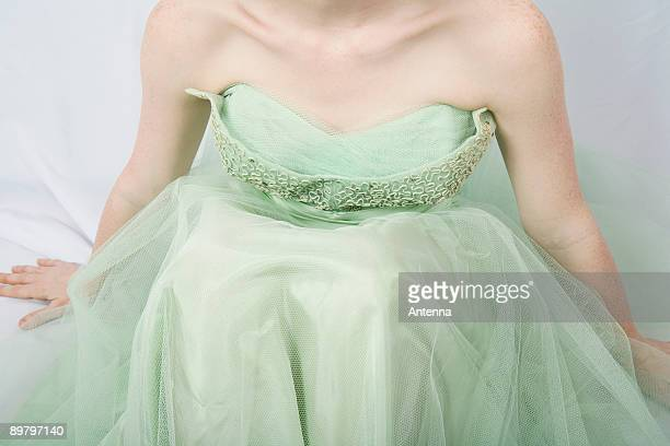 a young woman wearing a strapless vintage dress - strapless dress stock pictures, royalty-free photos & images