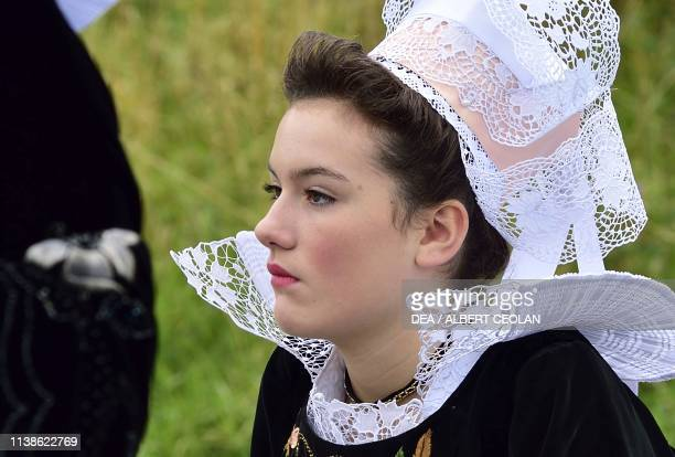 Young woman wearing a traditional costume with lace headdress Festival of Blue Nets Concarneau Brittany France