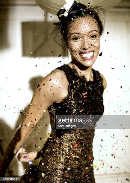 young woman wearing a veil with confetti falling. - evening wear stock pictures, royalty-free photos & images