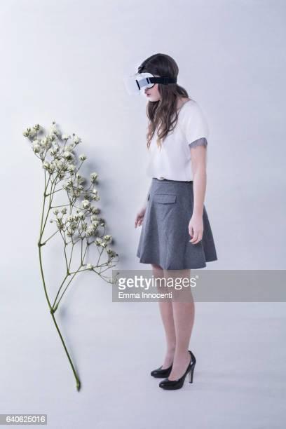 Young woman wearing a virtual reality headset