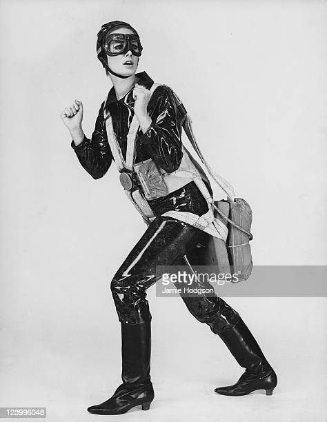 A young woman wearing an Aquasprite PVC suit and a parachute harness 13th May 1965