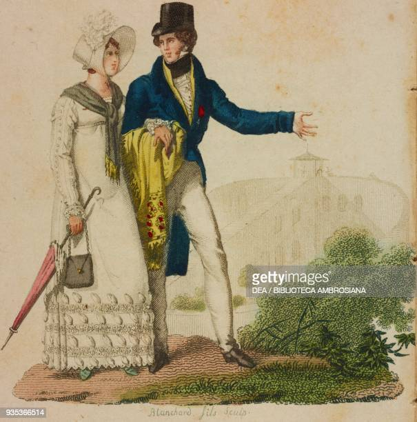 Young woman wearing an Empirestyle dress hat umbrella and bag young man wearing a tail coat and hat illustration from Almanach des modes et des...