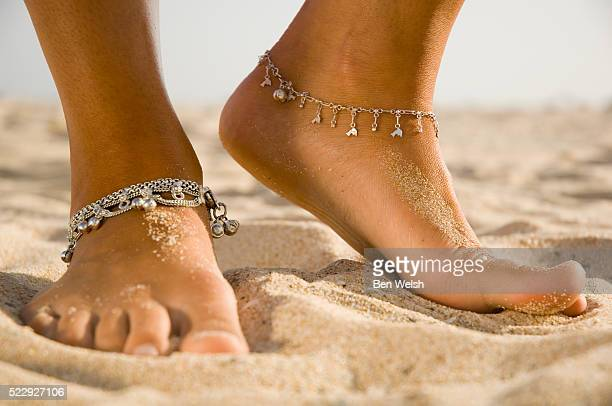 young woman wearing anklets on beach - anklet stock pictures, royalty-free photos & images