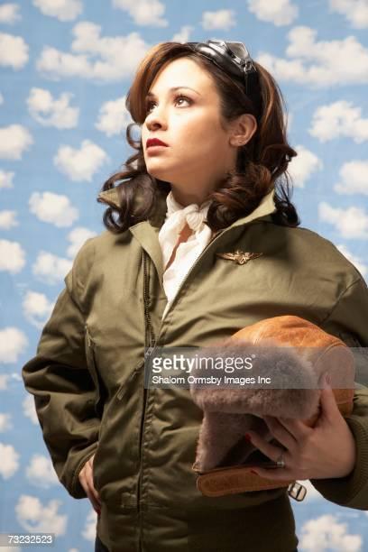 Young woman wearing aviator clothing