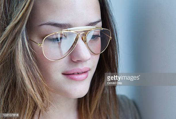 Young woman wearing aviator glasses