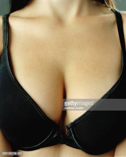 Young woman wearing black bra, mid section, close-up