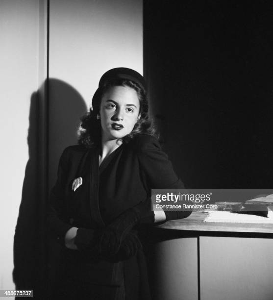 Young Woman Standing At Desk Pictures Getty Images