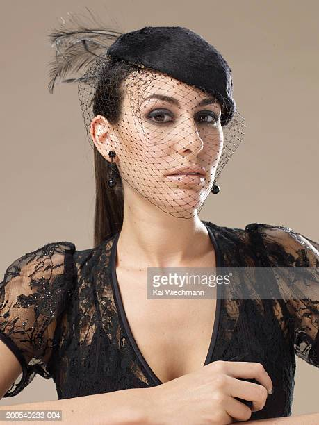 Young woman wearing black lace and veil, portrait