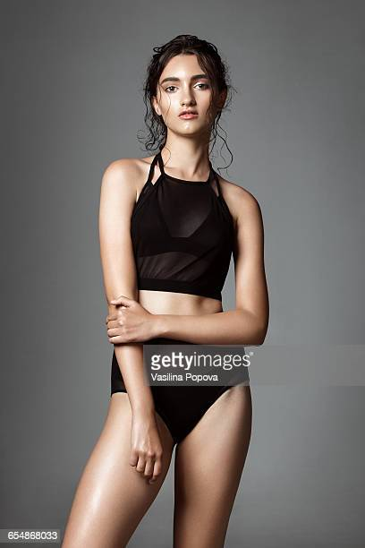 Young woman wearing black swimsuit