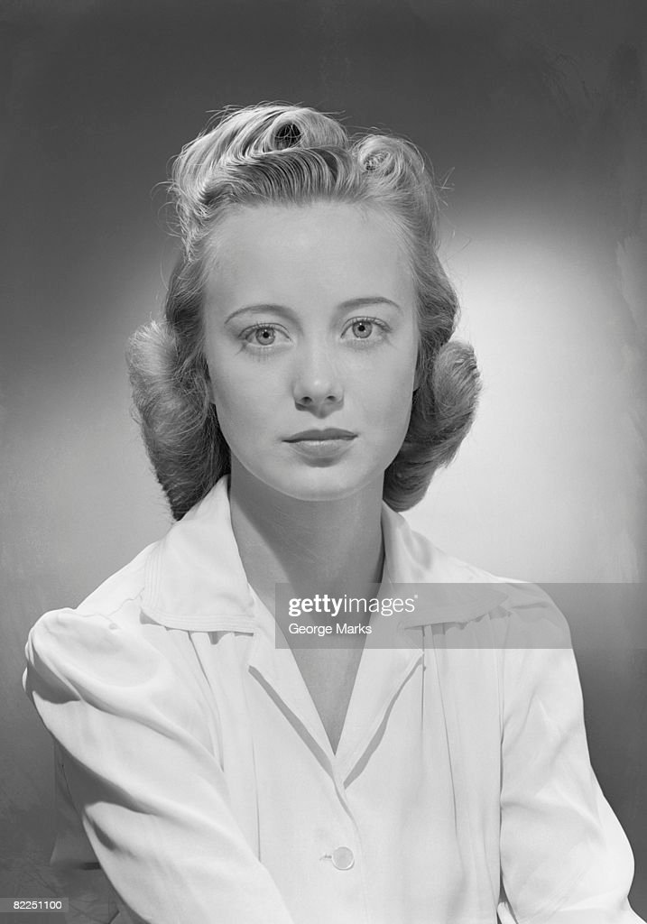 Young woman wearing blouse, portrait : Stock Photo