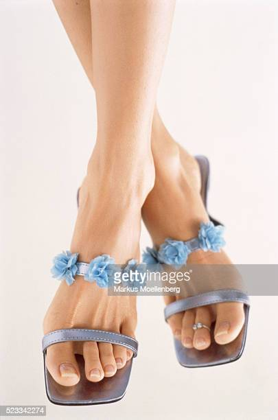 Young woman wearing blue sandals